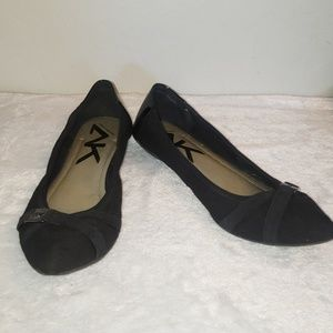 AK Sport black pointed toe flats